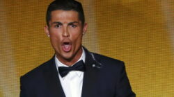 Real Madrid and Portugal forward Ronaldo reacts as he receives the FIFA Ballon d'Or award during the FIFA Ballon d'Or 2014 soccer awards ceremony in Zurich