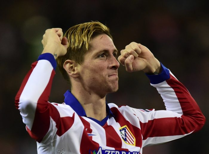 Atletico Madrid's forward Fernando Torres celebrates after scoring the opener during the Spanish Copa del Rey (King's Cup) quarter final second leg football match Club Atletico de Madrid vs FC Barcelona at the Vicente Calderon stadium in Madrid on January 28, 2015. AFP PHOTO/ JAVIER SORIANOJAVIER SORIANO/AFP/Getty Images ORIG FILE ID: 537255033